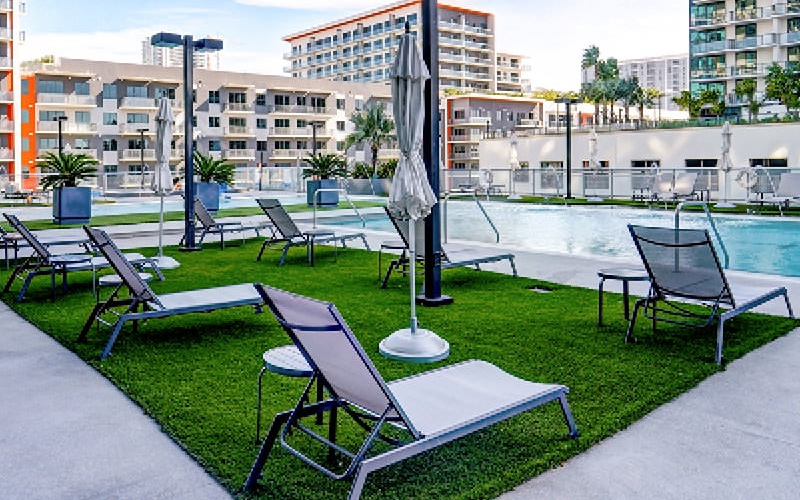 poolside lounge chairs on lawn